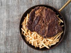 rustic steak frites - stock photo