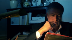 Businessman working in a dimly lit office 4k Stock Footage