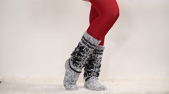 Woman in warm wool socks and pantyhose 4K. Stock Footage