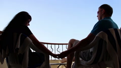 Loving Couple on the Balcony Embrace and Kiss With a View of the Sky Stock Footage
