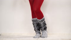 Woman in warm wool socks and pantyhose 4K. - stock footage