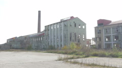 Complex of abandoned ruined factory halls and buildings,tracking shot,pan right. Stock Footage