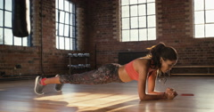Plank workout for fitness woman at the gym - stock footage