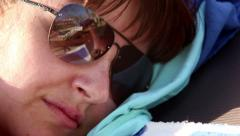 Woman in Sunglasses Relaxing, Teasing With Tongue Stock Footage