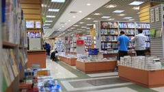 Asian people reading book at book store,Shanghai Stock Footage