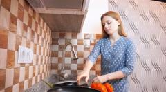 Gorgeous lady  washing Egg plant vegetables  Stock Footage