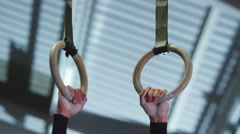 4K Professional male gymnast training on the rings at the gym.  - stock footage