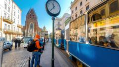 Street near the Holy Trinity church with Tram station in Krakow Stock Footage