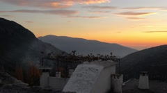 Stock Video Footage of Smoke rising from a chimney at sunset in the Alpujarras, Andalusia, Spain.