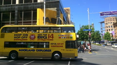Auckland Hop On Hop Off Explorer tour bus crossing Queen Street Stock Footage