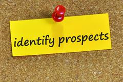 Identify prospects word on yellow notepaper with cork background Stock Photos