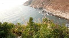 Climb down trodden footpath on green island hillside, POV shot Stock Footage