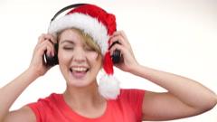 Woman in santa hat listening music. Chirstmas 4K. Stock Footage