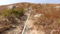 Climb up rocky dangerous path on mountain Stock Footage