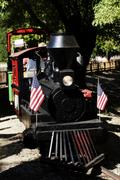 Miniature Rail Road Train With US Flags Stock Photos