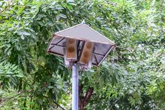 Rusty speakers with rainproof roof for announcement broadcasting. Stock Photos
