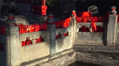 Stone bridge with a lot of pray blessing cloth,with water refection,xiangshan Stock Footage