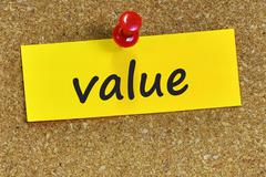value word on yellow notepaper with cork background - stock photo