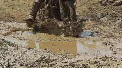 Enduro bike cross muddy stump track Stock Footage