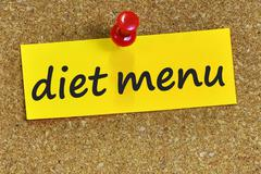 Diet menu word on yellow notepaper with cork background Stock Photos