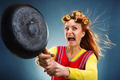Crazy housewife with pan - stock photo
