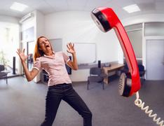 Big phone is screaming to woman - stock photo