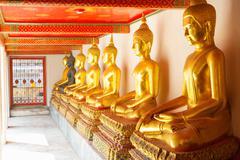 Golden statue in Wat Po Temple - stock photo