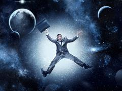 Businessman in space Stock Photos