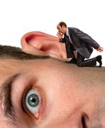 Businessman screaming to ear - stock photo