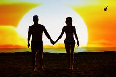 Silhouette of loving couple - stock photo