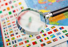 Magnifying glass on the flags Stock Photos