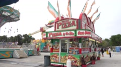 Pizza Stand And Pendulum Ride At Carnival Stock Footage