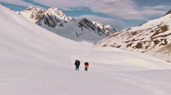 Climbers go up  to the mountain pass Stock Footage
