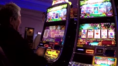 Close up people playing slot machine Stock Footage