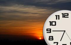 Good Morning clock with dawn landscape Stock Photos