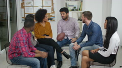 4K Creative business group using football to take turns to talk in meeting - stock footage