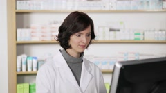 Stock Video Footage of Smiling confident female pharmacist