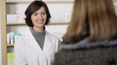 Patient handing a pharmacist a script Stock Footage