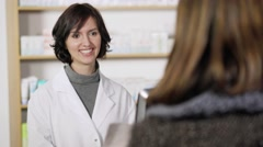 Friendly confident pharmacist taking a script - stock footage