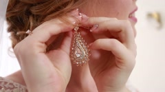 Hands of the bride dress beautiful earring - stock footage