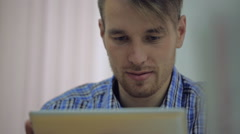 Attractive young business partner working in his studio Stock Footage