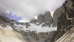 4K time lapse showing granite peaks partly hidden in fast-moving clouds Stock Footage