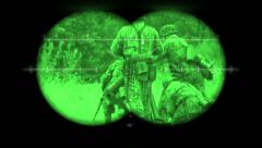 World War 2 battlefield re-enactment viewed through night vision binoculars Stock Footage