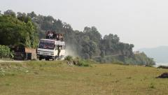 Nepalese bus on a rural road Stock Footage