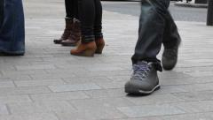Pedestrians' feet and passing pram on Oxford Street Stock Footage
