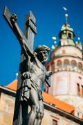 Statue of the Christian cross with Jesus in Cesky Krumlov, Czech - stock photo