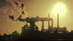 Powerplant silhouet with smokestacks, graded Stock Footage