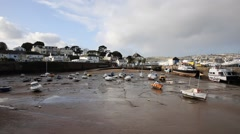 Paignton harbour Devon England near Torquay boats low tide - stock footage