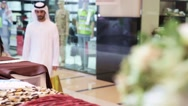 Emirati couple shopping at boutique. Stock Footage