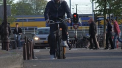 Long shot of cyclists and cars on the Singel Canal in Amsterdam Stock Footage